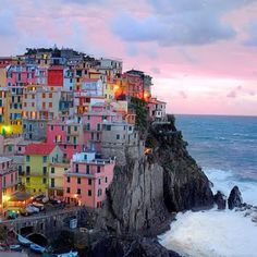 Cinq Terre - Italy- Certainly one of my most favorite places. There are many hiking trails and the views are spectacular. It doesn't matter where you eat, the food is incredible. Many of the trails are up hill so bring a comfortable pair of shoes!