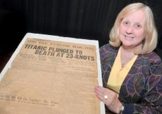 ELLEN O'CONNELL/Staff Photographer Rosemary Urillo of Hazleton displays an April 19, 1912 edition of an Extra The Evening Mail newspaper she found in a family-owned garage. The newspaper contains personal experiences of those who survived the sinking of the Titanic as well as stories of those who perished.