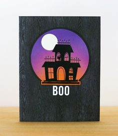"handmade Halloween card from INKlinations ... black base stamped with woodgrain ... purple and orange sponged circle with with moon  ... silhouette haunted house ... clean lines ... great design ... ""BOO""!"