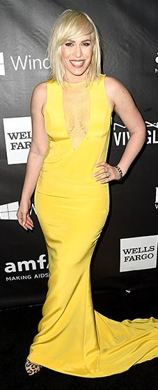 Natasha Bedingfield brought some sunshine to the carpet in a yellow dress that boasted a deep V neckline and a slight train.
