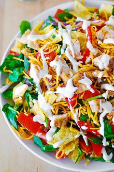 Chicken Taco Salad.. this looks amazing.  I will try to  lighten it up a bit for my Shrinking On a Budget Meal Plan.  Maybe I'll even add a tiny bit of chipotle and lime into the ranch dressing.