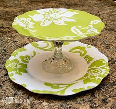 Create your own tiered serving piece. Will need: Salad, tea cup saucer, bonding glue and glass candle stick hold. How to is quite simple, Salad plate is glued to saucer, which is glued to candlestick, which is glued to salad or saucer plate. Super easy!!!