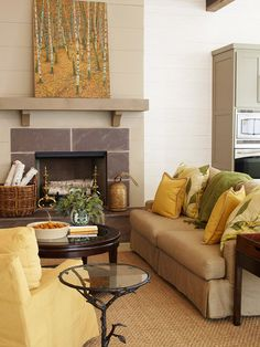 Yellow & Green Living Room. this is a great illustration of how to work with neutral colors as the base and use artwork and accessories to add color. Easy to switch out by season.