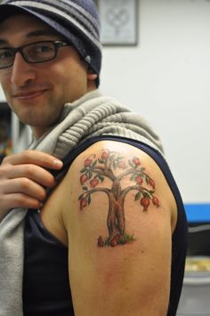 pomegranate tree tattoo, MEANING:  fertility, righteousness, ROMAN MEANING: sacredness of marriage - in some cultures, the pomegranate is a symbol of life, death and rebirth.
