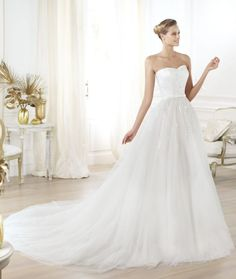 A classic @Pronovias wedding dress with just a touch of sparkle!