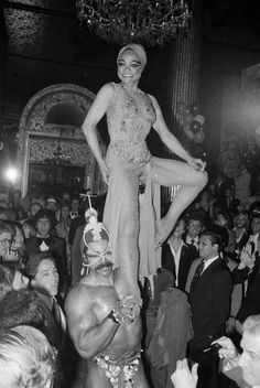 May 11, 1978. Eartha Kitt, star of the Broadway Play Timbuktu!, arrives on the shoulders of Tony Carroll, Mr. Universe of 1977, at New York's Waldorf Astoria.