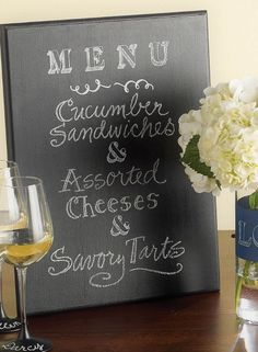 Let your guests see just what's for dinner -- DIY Menu Chalkboard tutorial.