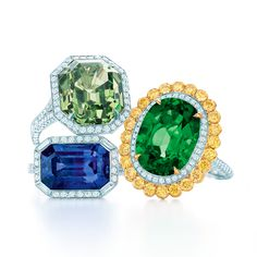 Rings with diamonds in platinum, from left: grossularite, sapphire and an emerald with yellow diamonds in 18k gold. #TiffanyPinterest #TiffanyBlueBook