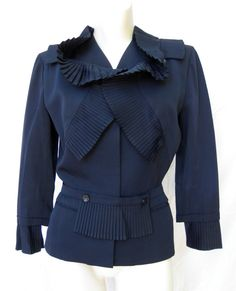 "Gilbert Adrian  1940s jacket with lots of wonderful pleats.  He was a Hollywood designer to the stars like Joan Crawford and also designed the costumes for ""The Wizard of Oz"". This would look great with so many things."
