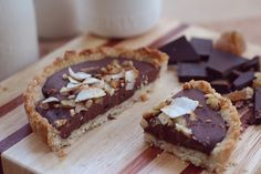 Chocolate Tarts made with almond flour, coconut oil, dark chocolate, dates, coconut, and coconut milk.