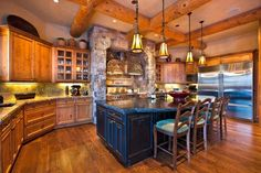 Log Cabin Kitchen....love the stone hearth!