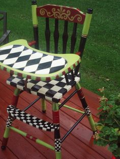harlequin painted baby chair