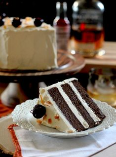 Chocolate cake with whiskey buttercream, boozy cherries, and candied orange peel