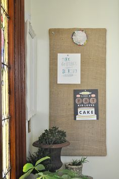 love the long, narrow burlap covered inspiration board (make it magnetic with sheet metal underneath)