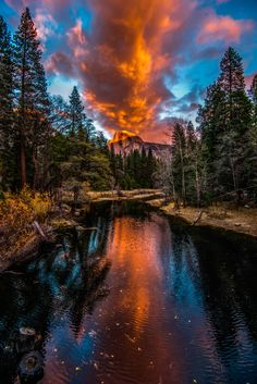 """The Eruption"" (blazing sunset reflects in calm waters, Half Dome, Yosemite National Park, California)"
