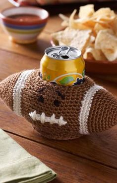 Football Can Cozy Crochet Pattern - Perfect for the big game (and so cute) via @Red Heart Yarns