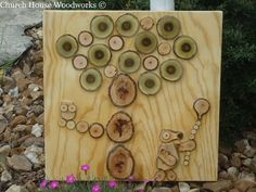 "Wood Wall Art For Kids Nursery For Sale. One of a kind. Handmade using real tree slices. The picture has a bear holding a balloon and an owl sitting on a tree branch. The wood slices are mostly hickory with the exception of the green wood slices which are a variety of a locust tree and YES those are naturally green.The dimensions measure approx. 20"" x 20"".The entire art work is sealed with a clear coat finish."