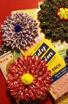Sweet! Make cute flowers out of rick rack!  Tutorial Tuesday: folk style hearts | Mollie Makes