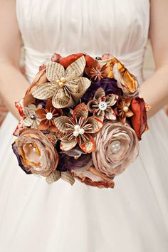 """""""Book page and fabric flowers make a gorgeous wedding bouquet. Some edges are slightly dyed with color.""""  Gah, so creative! And being such a packrat, I know I'd keep it for the rest of my life. :) And it'd be so cheap too! #wedding #flowers #crafts"""