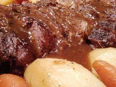 Mama's Pot Roast... slow roasted chuck roast with potatoes, carrots and gravy! YUM!