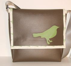 "Sweet vinyl messenger bag. Available at ""I like you"" in Minneapolis. Tweet, tweet."