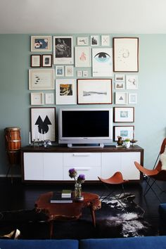 Nothing can stick out like a sore thumb as much as a giant TV in your living space. There are certainly ways to hide the fact that you have a large, black, plastic monster sitting in your room. We certainly can't give up TVs all together! Here are a few functional ideas to display your TV in a stylish way.