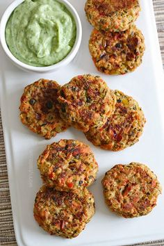 These baked salmon cakes are light and healthy! Served with my favorite zesty avocado cilantro sauce for dipping  absolutely addicting!