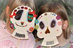 Dia De los Muertos masks made from paper plates.