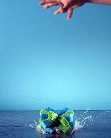 DIY Sponge Ball by marthastewart: Squishy fun for a game of tag on a hot summer day or in the bathtub. #Sponge_Ball #Martha_Stewart #Crafts