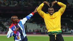 Gold medallists Mo Farah and Usain Bolt of Jamaica pose on the podium