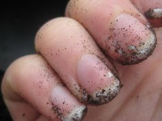 Great tip! Before gardening/yard work, drag your nails across a bar of soap, claw-like. The soapy buildup will protect the area under the nail bed from a soily invasion. Once you are done mucking about in the dirt you'll find that washing up is a breeze!