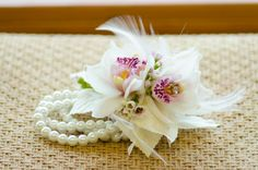 White and pink cymbidium orchids with bling accents, white feathers and a pearl wristlet. aubrey lynn, floral inspir, austin floral, flower 2013, lynn big, prom 2013, prom flower, howto idea