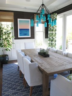 Canopy Designs Aruba Blue Sara Chandelier, Madeline Weinrib Indigo Brooke Rug, Peter Dunham Textiles Fig Leaves