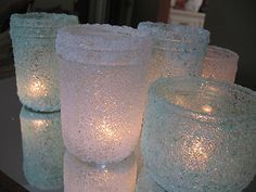 Decorate jars with epsom salts and put candles in them