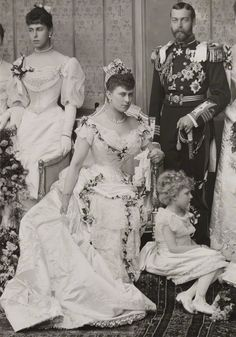 Future King George IV and wife Mary of Teck.1893.  They are the grandparents of Queen Elizabeth II.  Elizabeth resembles her grandmother very much.