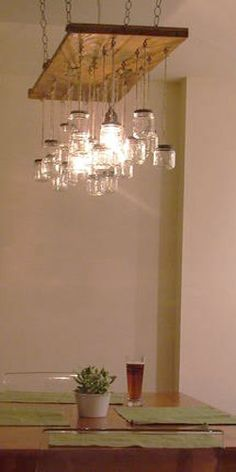 mason jars hanging from an old piece of wood diy.You can build this easily from the great instructions given, simply go and choose from over 16,000 plans at http://www.vickswoodworkingplans.com/