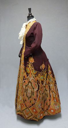 Heavily-embroidered burgundy dressing gown, 1888.