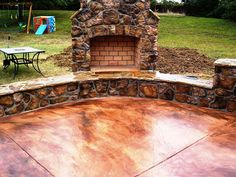 Concrete patio, acid stained concrete, love the fireplace too!
