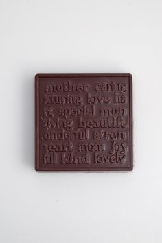Solid chocolate block molded with loving words about Mom