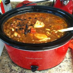 """""""Mexican Soup"""" one 28oz can diced tomatoes, one jar salsa, two 15.25oz cans black beans, two 15.5oz cans chili beans, 4 frozen chicken breasts, chili powder and medium onion. High for 4 hours. Take chicken out and shred with two forks. Place back in crock pot and cook additional 30 minutes. Serve with crushed tortilla chips or cheese and sour cream, delicious. (Do not drain any juice from the cans as this provides the juice for the soup.) ENJOY. :)"""