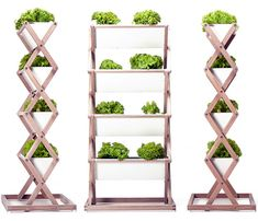 Jörg Brachmann's collapsible vertical planter is perfect for small spaces. Grow vegetables, then fold it up for easy storage off-season! #urbangardens garden planters, garden stand, foldabl garden, foldabl laundri, small vegetable garden layout, urban garden, hang garden, scissor, hanging gardens