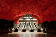 This subway in Stockholm has a natural bedrock ceiling that's been painted