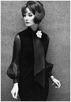Tania Mallet in black cocktail dress with chiffon sleeves by Frederick Starke. Photo by John French, April 1964