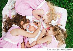 Newborn pose with siblings