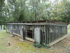 Houses of Spirits - This grave house in southern Kentucky's Muhlenberg County has a shed-style roof, and the tombstones are placed outside, demonstrating, perhaps, that the main concern here is protecting the grave rather than the stone.