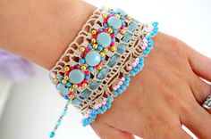 Hard to tell but this looks like it might be old lace with beads and ribbon attached. Cute! crochet beaded bracelet