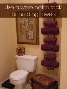 Use a Wine Bottle Rack for Holding & Organizing towels. Using a wine bottle rack is perfect for an elegent look in the bathroom, and also for small bathrooms without storage space.