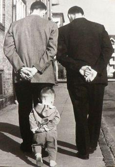 Generations.  father  son  boy robertdoisneau, big boys, growing up, children, son, robert doisneau, pay attention, kid, father
