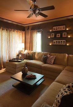 Looks so warm and cozy.  I love the tea lights on the shelves! This is a small room like ours!