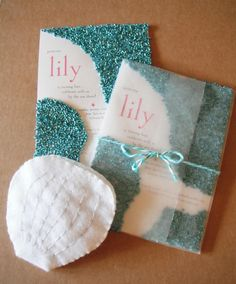Mermaid tail invitations - seen of Noteworthy Impressions blog - The glittering mermaid tail invitations were wrapped in waxed paper and yarn before being hand delivered. MY FAVORITE!